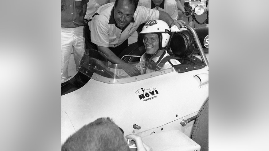 In this May 25, 1963, file photo, Andy Granatelli, car building and owner, leans over to congratulate Bobby Unser after the Albuquerque, N.M., driver qualified one of the V-8 Novi-powered racers for the Indianapolis 500 auto race in Indianapolis. The rookie driver was fastest qualifier, averaging 149.421 mph for four-laps. Two other Novis, one driven by Jim Hurtubise and the other by rookie Art Malone, qualified for the race. (AP Photo/File)