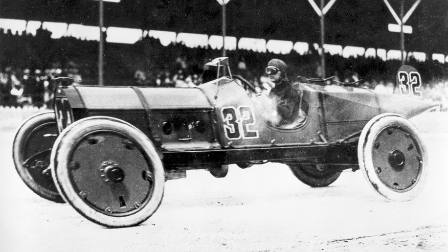FILE - In this May 30, 1911, file photo, Ray Harroun drives his No. 32 Marmon Wasp race car to victory in the inaugural Indianapolis 500 auto race at the Indianapolis Motor Speedway, in Indianapolis, Ind. (AP Photo/File)