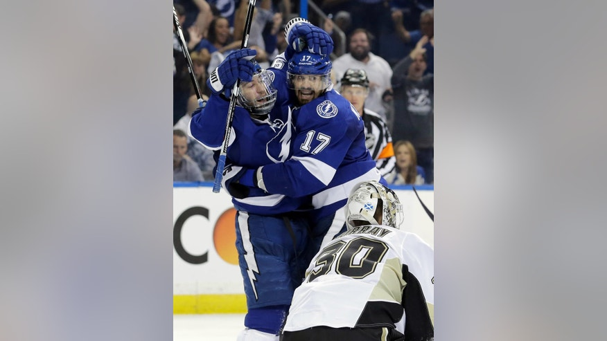 Tampa Bay Lightning's Tyler Johnson, left, celebrates his goal with teammate Alex Killorn (17), next to Pittsburgh Penguins goalie Matt Murray (30) during the second period of Game 4 of the NHL hockey Stanley Cup Eastern Conference finals Friday, May 20, 2016, in Tampa, Fla. (AP Photo/Chris O'Meara)
