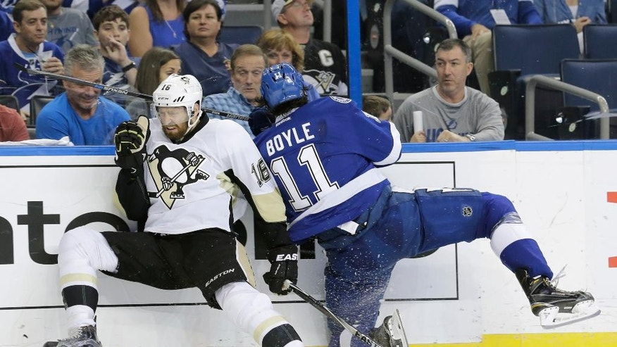 Pittsburgh Penguins' Eric Fehr (16) and Tampa Bay Lightning's Brian Boyle (11) collide during the second period of Game 4 of the NHL hockey Stanley Cup Eastern Conference finals Friday, May 20, 2016, in Tampa, Fla. (AP Photo/Chris O'Meara)