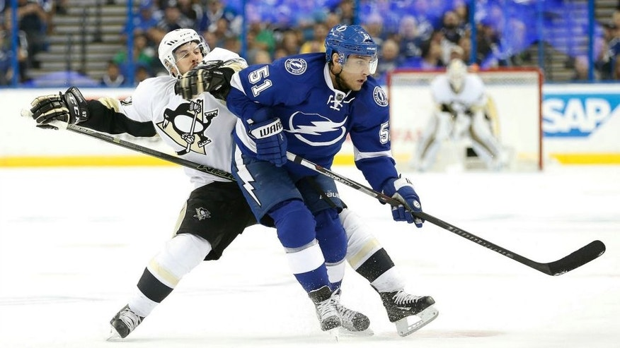 May 20, 2016; Tampa, FL, USA; Pittsburgh Penguins center Sidney Crosby (87) and Tampa Bay Lightning center Valtteri Filppula (51) fight to control the puck during the second period of game four of the Eastern Conference Final of the 2016 Stanley Cup Playoffs at Amalie Arena. Mandatory Credit: Kim Klement-USA TODAY Sports