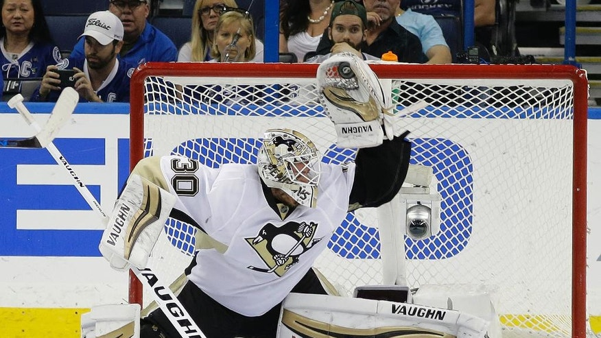 Pittsburgh Penguins goalie Matt Murray (30) makes a glove save on a shot by the Tampa Bay Lightning during the third period of Game 3 of the NHL hockey Stanley Cup Eastern Conference Finals Wednesday, May 18, 2016, in Tampa, Fla. The Penguins won the game 4-2. (AP Photo/Chris O'Meara)