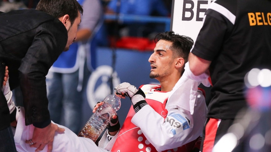 In this May 19, 2016 picture Belgium's Mourad Laachraoui takes a break during his fight against Spain's Jesus Tortosa Cabrera, during their men -54kg final at the European Taekwondo Championships in Montreux, Switzerland.