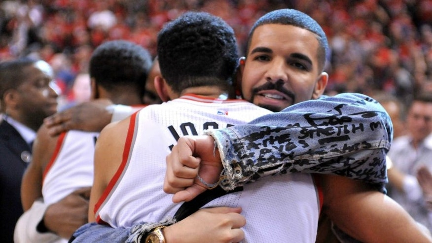 May 1, 2016; Toronto, Ontario, CAN; Recording artist Drake embraces Toronto Raptors guard Cory Joseph (6) as they celebrate a 89-84 win over Indiana Pacers in game seven of the first round of the 2016 NBA Playoffs at Air Canada Centre. Mandatory Credit: Dan Hamilton-USA TODAY Sports
