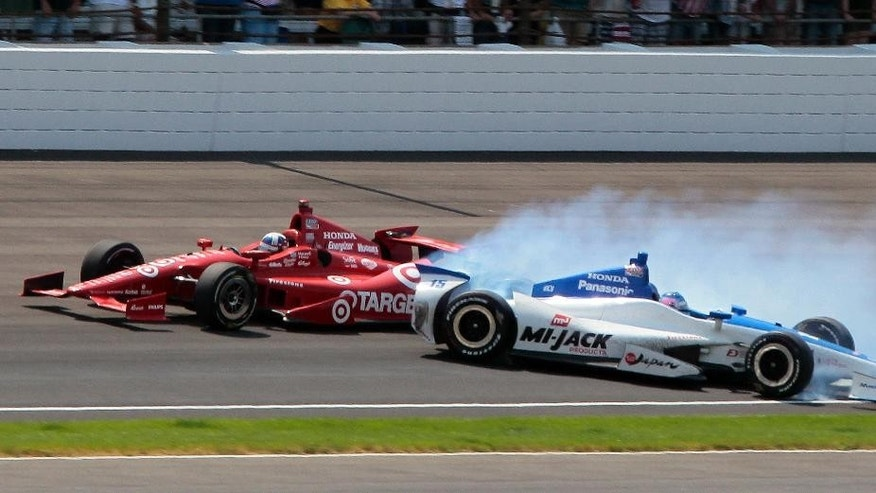 FILE - In this May 27, 2012, file photo, Takuma Sato, right, of Japan, spins in the first turn under Dario Franchitti, of Scotland, on the final lap of IndyCar's Indianapolis 500 auto race at Indianapolis Motor Speedway in Indianapolis. (AP Photo/Bill Friel, File)