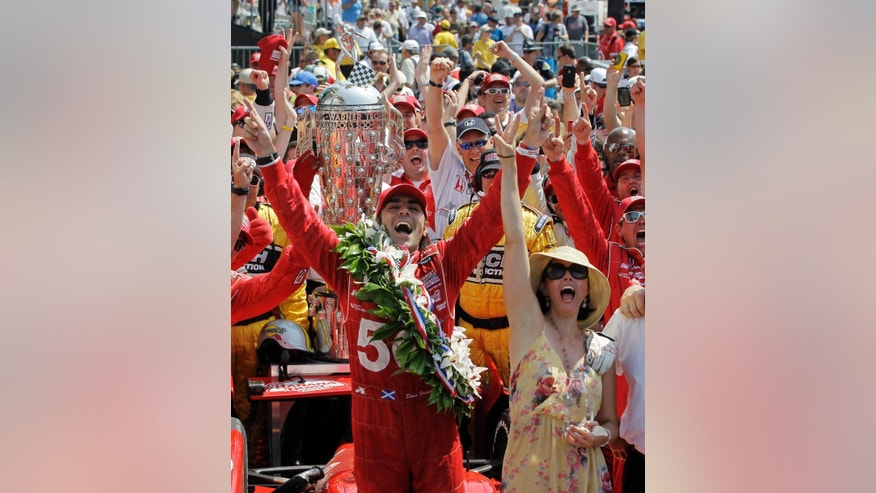 FILE - In this May 27, 2012, file photo, Dario Franchitti, of Scotland, and his wife, actress Ashley Judd, celebrate in victory circle after winning IndyCar's Indianapolis 500 auto race at Indianapolis Motor Speedway in Indianapolis. (AP Photo/Darron Cummings, File)