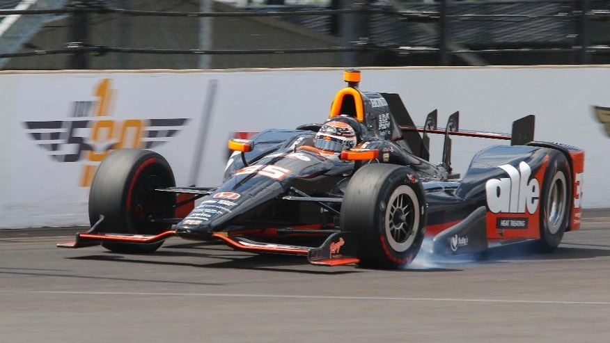 Alex Tagliani, of Canada, wrecks during qualifications for the Indianapolis 500 auto race at Indianapolis Motor Speedway in Indianapolis, Sunday, May 22, 2016. (AP Photo/Kirk Stierwalt)