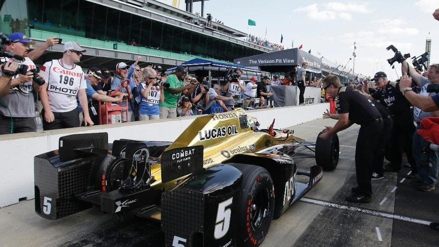 James Hinchcliffe, of Canada, celebrates after winning the pole for the Indianapolis 500 auto race at Indianapolis Motor Speedway in Indianapolis, Sunday, May 22, 2016. (AP Photo/Darron Cummings)