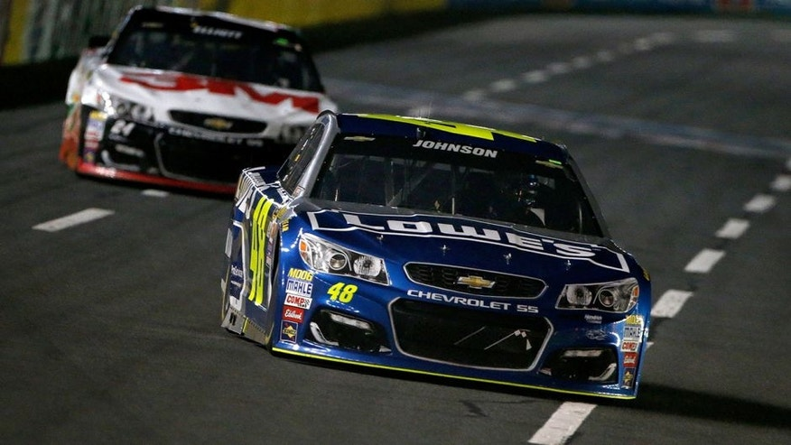 CHARLOTTE, NC - MAY 21: Jimmie Johnson, driver of the #48 Lowe's Chevrolet, leads Chase Elliott, driver of the #24 3M Chevrolet, during the NASCAR Sprint Cup Series Sprint All-Star Race at Charlotte Motor Speedway on May 21, 2016 in Charlotte, North Carolina. (Photo by Brian Lawdermilk/Getty Images)