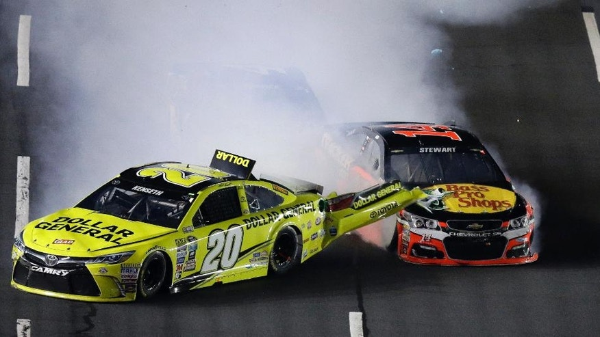 Matt Kenseth (20) is hit from behind by Tony Stewart during the NASCAR Sprint All-Star auto race at Charlotte Motor Speedway in Concord, N.C., Saturday, May 21, 2016. (AP Photo/Gerry Broome)