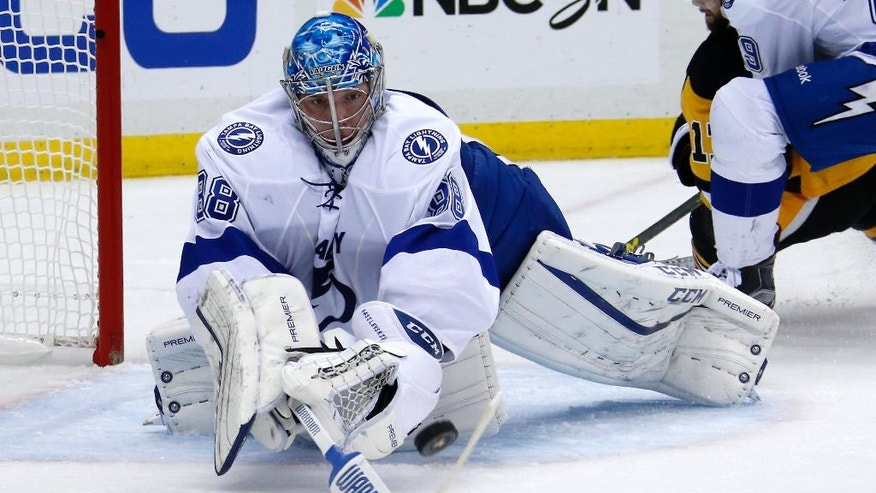 Tampa Bay Lightning goalie Andrei Vasilevskiy stops a shot during the second period of Game 5 of the NHL hockey Stanley Cup Eastern Conference finals against the Pittsburgh Penguins, Sunday, May 22, 2016 in Pittsburgh. (AP Photo/Gene J. Puskar)