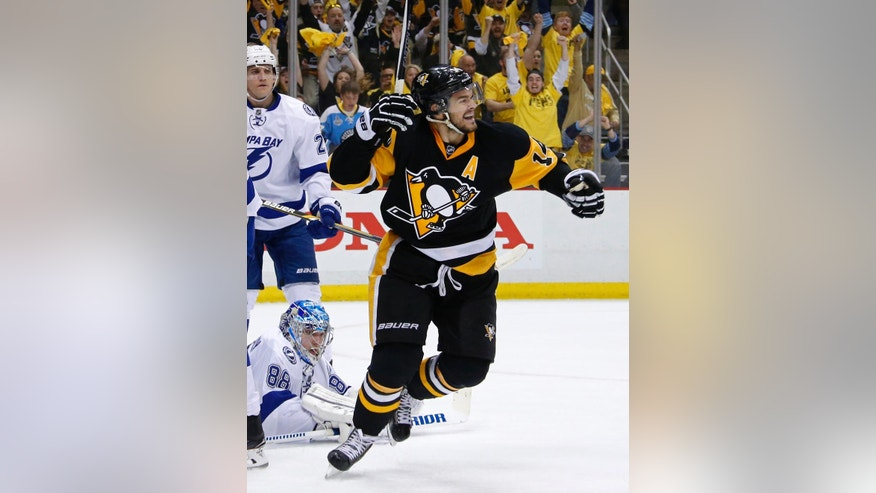 Tampa Bay Lightning goalie Andrei Vasilevskiy watches as Pittsburgh Penguins' Chris Kunitz celebrates his goal during the second period of Game 5 of the NHL hockey Stanley Cup Eastern Conference finals, Sunday, May 22, 2016 in Pittsburgh. (AP Photo/Gene J. Puskar)