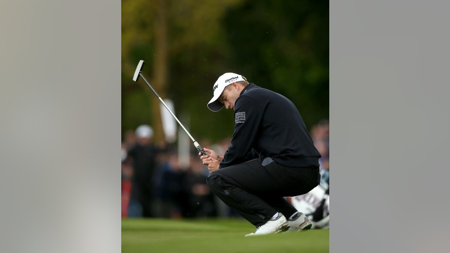 Scotland's Russell Knox reacts after missing a putt on the 13th hole during day four of the Irish Open at The K Club, in Straffan, Ireland, Sunday May 22, 2016. (Brian Lawless / PA via AP) UNITED KINGDOM OUT - NO SALES - NO ARCHIVES