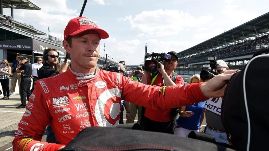 Scott Dixon, of New Zealand, stores his helmet after qualifying for the Indianapolis 500 auto race at Indianapolis Motor Speedway in Indianapolis, Sunday, May 22, 2016. (AP Photo/Michael Conroy)