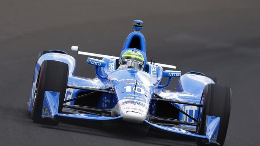 Tony Kanaan, of Brazil, drives the the first turn during a practice session on the opening day of qualifications for the Indianapolis 500 auto race at Indianapolis Motor Speedway in Indianapolis, Saturday, May 21, 2016. (AP Photo/Michael Conroy)