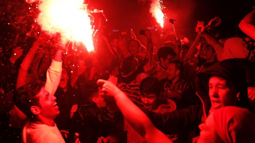 FC Barcelona's supporters burn flares as they celebrate their team's victory in the Copa del Rey title at Canaletas source at Las Ramblas in Barcelona, Spain, early Monday, May 23, 2016. FC Barcelona won the final of the Copa del Rey soccer match between FC Barcelona and Sevilla FC. (AP Photo/Manu Fernandez)