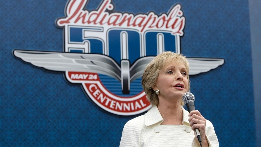"FILE - In this May 24, 2009, file photo, singer and actress Florence Henderson sings ""God Bless America"" before the 93rd running of the Indianapolis 500 auto race at the Indianapolis Motor Speedway in Indianapolis. Henderson will be the grand marshal for the 100th running of the Indianapolis 500 next weekend. (AP Photo/Darron Cummings, File)"