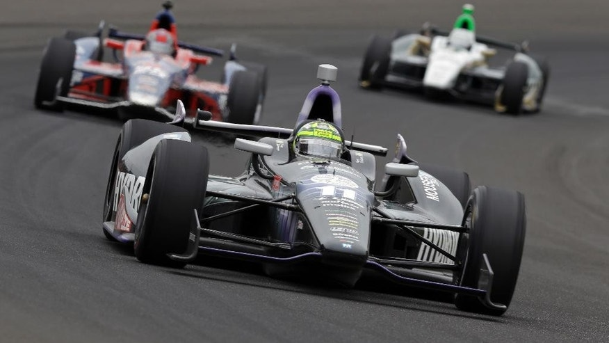 FILE - In this May 26, 2013, file photo, Tony Kanaan, of Brazil, drives through the first turn during the Indianapolis 500 auto race at the Indianapolis Motor Speedway in Indianapolis. Kanaan won the race. (AP Photo/Tom Strattman, File)