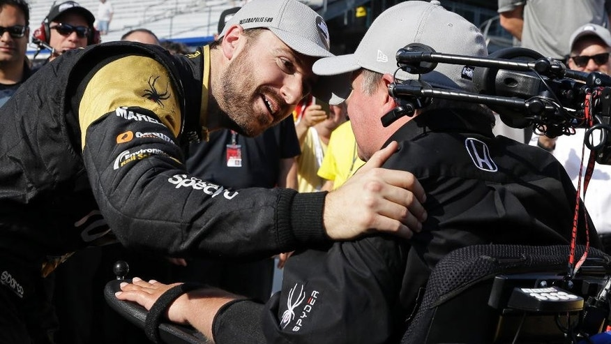 James Hinchcliffe, of Canada, celebrates with car owner Same Schmidt after winning the pole during qualifications for the Indianapolis 500 auto race at Indianapolis Motor Speedway in Indianapolis, Sunday, May 22, 2016. (AP Photo/Michael Conroy)