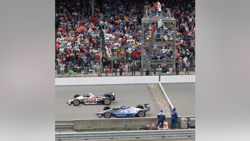 FILE - In this May 24, 1992, file photo, Al Unser Jr., top, of Albuquerque, N.M., wins the Indianapolis 500 by less than a car length ahead of Scott Goodyear, of Canada, at Indianapolis Motor Speedway in Indianapolis.  (AP Photo/David Boe, File)