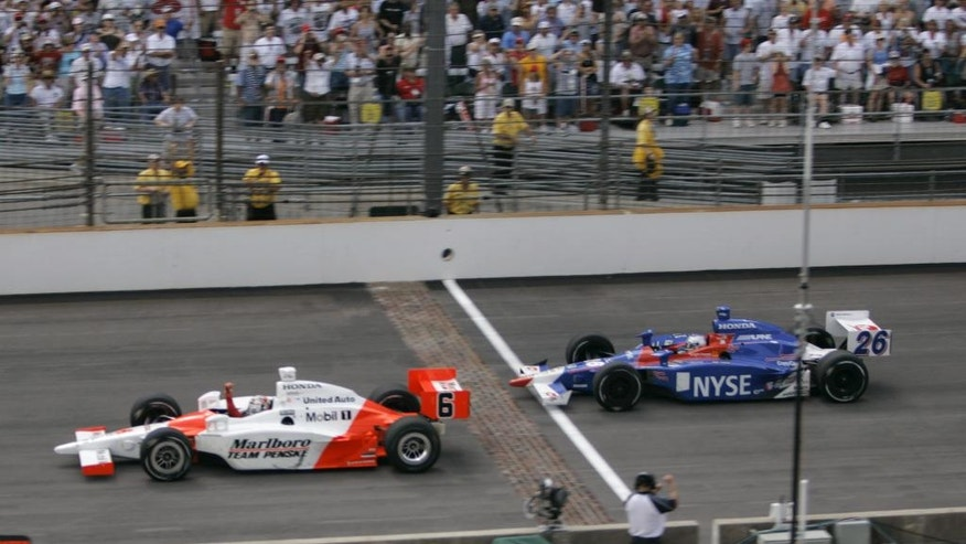 FILE - In this May 28, 2006, file photo, Sam Hornish Jr., left, pumps his fist as he beats Marco Andretti to the finish line to win the Indianapolis 500 auto race at Indianapolis Motor Speedway in Indianapolis.  (AP Photo/Dave Parker, File)