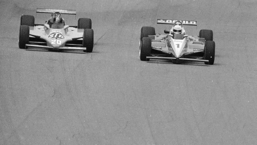 FILE - In this May 31, 1982, file photo, Gordon Johncock (20) and Rick Mears (1) race in the Indianapolis 500 auto race in Indianapolis. Johncock beat Mears by 0.16 second. (AP Photo/File)