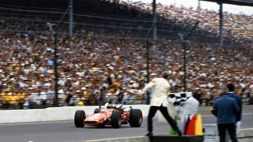 "In this May 30, 1969 photo provided by Indianapolis Motor Speedway, Mario Andretti takes the checkered flag as he wins the 53rd running of the Indianapolis 500 auto race at Indianapolis Motor Speedway in Indianapolis, Ind. In the lead-up to the 100th running of the ""The Greatest Spectacle in Racing,"" The Associated Press interviewed the 27 living race winners on topics ranging from the best driver to greatest tradition. ""No question, there's nothing that can match seeing the checkered flag,"" said 1969 winner Mario Andretti. (IMS via AP)"