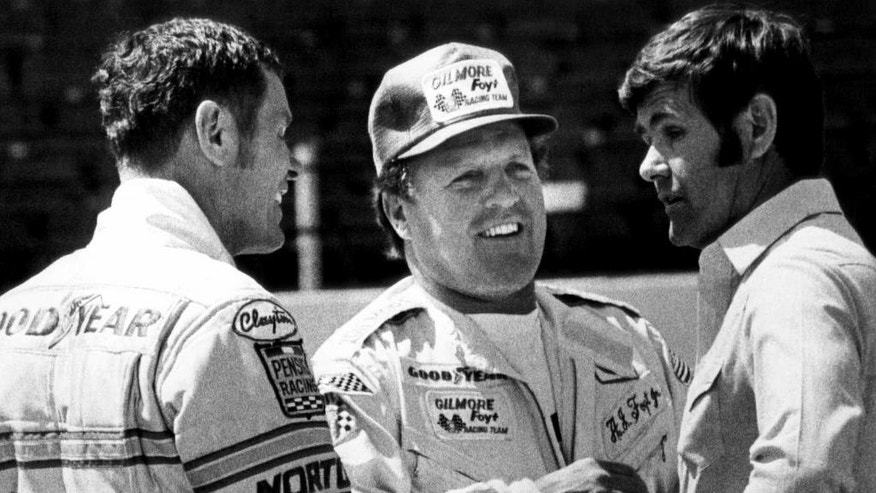 FILE - In this May 15, 1980,  file photo, racedrivers Bobby Unser, left, A.J. Foyt, and Al Unser, right, talk at the speedway in Indianapolis. Long before he won the Indianapolis 500, Al Unser was an up-and-coming 25-year-old sprint car driver who had showed up at Indianapolis Motor Speedway to watch his older brother try to qualify.  (AP Photo/File)