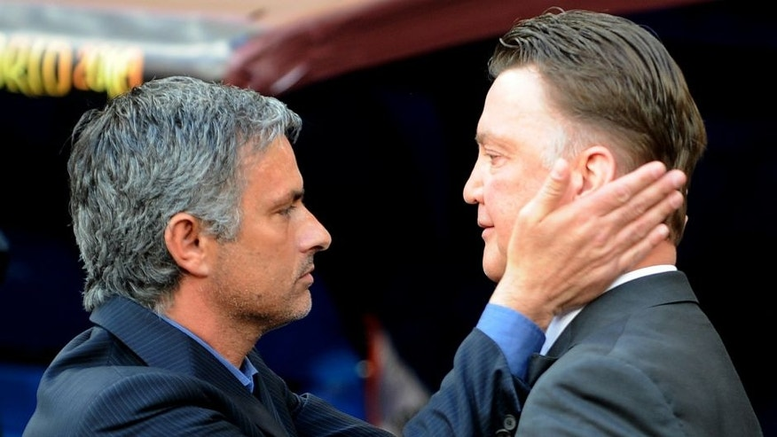Bayern Munich's Dutch head coach Louis van Gaal (R) and Inter Milan's Portuguese coach Jose Mourinho greet each other before the UEFA Champions League final football match Inter Milan against Bayern Munich at the Santiago Bernabeu stadium in Madrid on May 22, 2010. AFP PHOTO / PEDRO ARMESTRE (Photo credit should read PEDRO ARMESTRE/AFP/Getty Images)