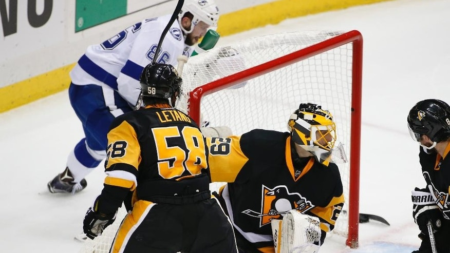 Tampa Bay Lightning's Nikita Kucherov, left, brings the puck around the goal to score on Pittsburgh Penguins goalie Marc-Andre Fleury (29) during the third period of Game 5 of the NHL hockey Stanley Cup Eastern Conference finals, Sunday, May 22, 2016, in Pittsburgh. (AP Photo/Gene J. Puskar)
