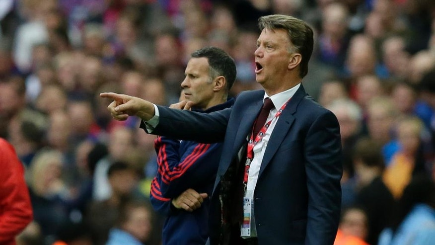 Manchester United's manager Louis van Gaal gestures to his players during the English FA Cup final soccer match between Manchester United and Crystal Palace at Wembley Stadium, London on Saturday May 21, 2016. (AP Photo/Tim Ireland)