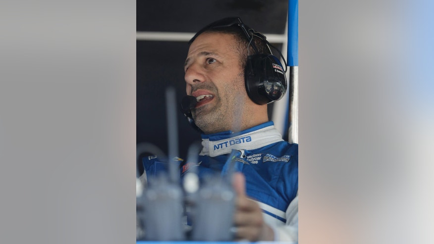 Tony Kanaan, of Brazil, talks with his crew during a practice session for the Indianapolis 500 auto race at Indianapolis Motor Speedway in Indianapolis, Monday, May 23, 2016. (AP Photo/Darron Cummings)