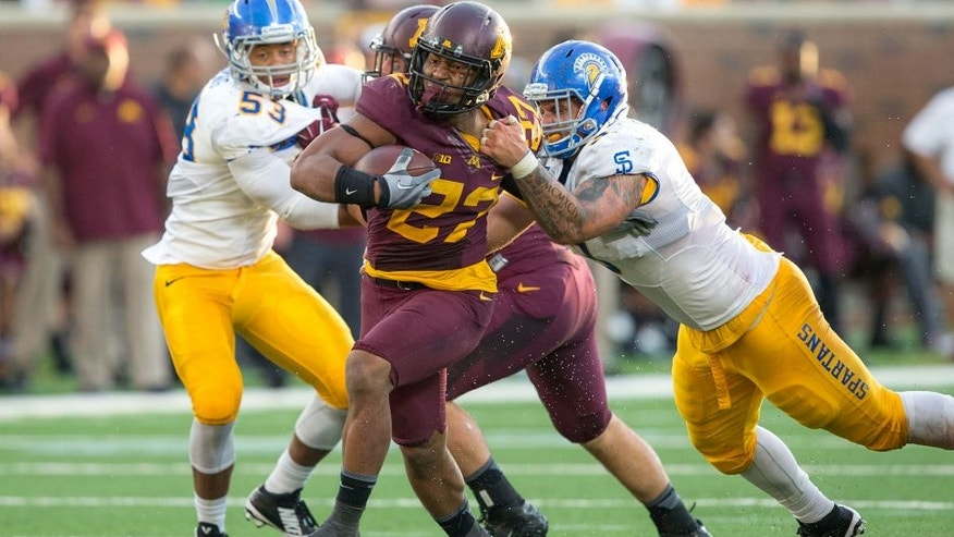 Sep 20, 2014; Minneapolis, MN, USA; Minnesota Golden Gophers running back David Cobb (27) breaks away from a tackle from San Jose State Spartans defensive tackle Travis Raciti (3) in the second half at TCF Bank Stadium. The Gophers won 24-7. Mandatory Credit: Jesse Johnson-USA TODAY Sports