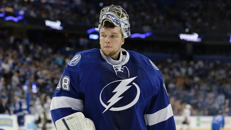 Tampa Bay Lightning goalie Andrei Vasilevskiy (88), of Russia, takes a break after Pittsburgh Penguins right wing Phil Kessel (81) scored a goal during the first period of Game 6 of the NHL hockey Stanley Cup Eastern Conference finals Tuesday, May 24, 2016, in Tampa, Fla. (AP Photo/Chris O'Meara)