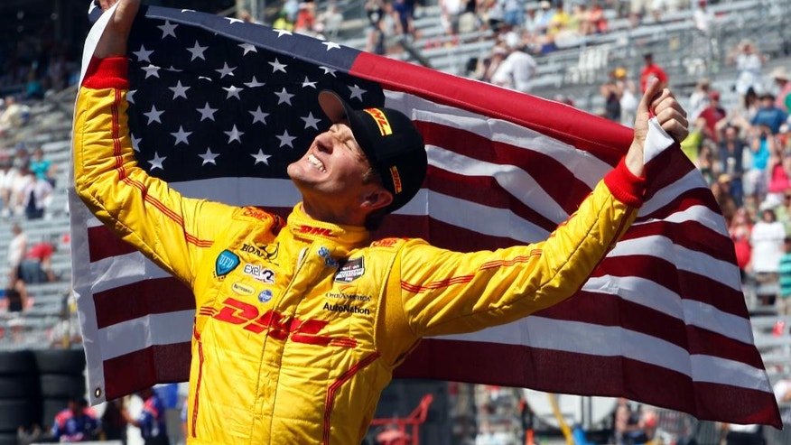 FILE - In this May 25, 2014, file photo, Ryan Hunter-Reay celebrates after winning the 98th running of the Indianapolis 500 auto race at the Indianapolis Motor Speedway in Indianapolis. (AP Photo/Tom Strattman, File)