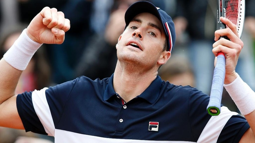 John Isner of the U.S. reacts as he defeats Australia's John Millman during their first round match of the French Open tennis tournament at the Roland Garros stadium, Tuesday, May 24, 2016 in Paris.  (AP Photo/Alastair Grant)