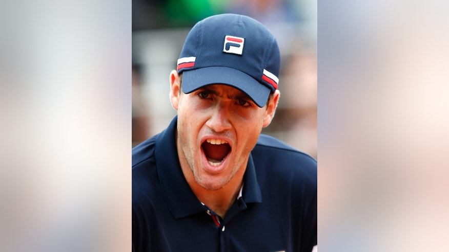 John Isner of the U.S. reacts as he plays Australia's John Millman during their first round match of the French Open tennis tournament at the Roland Garros stadium, Tuesday, May 24, 2016 in Paris.  (AP Photo/Alastair Grant)