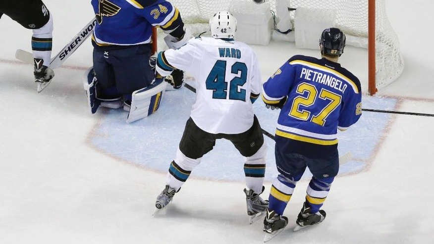 San Jose Sharks right wing Joel Ward (42)  gets the puck past St. Louis Blues goalie Jake Allen (34) for a score during the second period in Game 5 of the NHL hockey Stanley Cup Western Conference finals, Monday, May 23, 2016, in St. Louis. (AP Photo/Jeff Roberson)