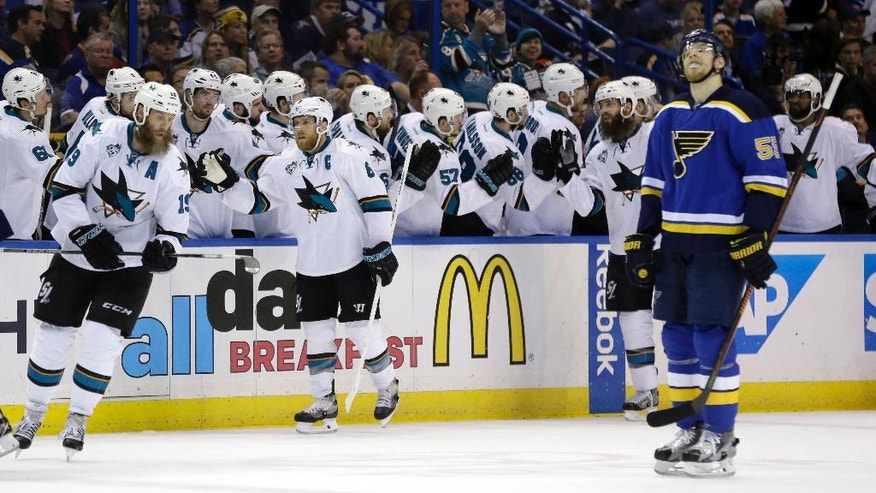 San Jose Sharks center Joe Pavelski (8) celebrates with teammates after scoring a goal during the second period in Game 5 of the NHL hockey Stanley Cup Western Conference finals, Monday, May 23, 2016, in St. Louis. At right is St. Louis Blues defenseman Colton Parayko (55). (AP Photo/Jeff Roberson)