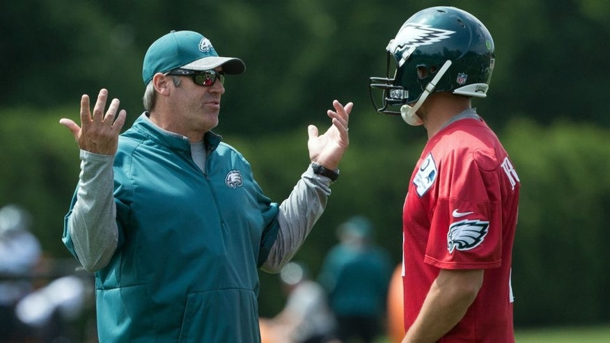 May 24, 2016; Philadelphia, PA, USA; Philadelphia Eagles head coach Doug Pederson talks with quarterback Sam Bradford (7) during OTS's at the NovaCare Complex. Mandatory Credit: Bill Streicher-USA TODAY Sports