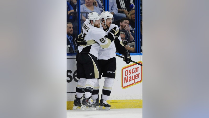 Pittsburgh Penguins right wing Phil Kessel (81) celebrates Sidney Crosby's (87) goal during the second period of Game 6 of the NHL hockey Stanley Cup Eastern Conference finals against the Tampa Bay Lightning, Tuesday, May 24, 2016, in Tampa, Fla. (AP Photo/Chris O'Meara)