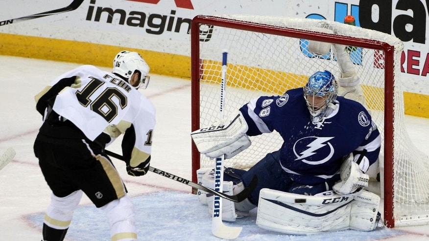 Tampa Bay Lightning goalie Andrei Vasilevskiy (88), of Russia, stops a shot on goal by Pittsburgh Penguins right wing Eric Fehr (16), during the first period of Game 6 of the NHL hockey Stanley Cup Eastern Conference finals Tuesday, May 24, 2016, in Tampa, Fla. (AP Photo/Brian Blanco)