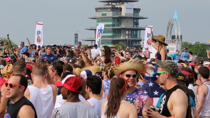 FILE - In this May 24, 2015, file photo, fans gather for a concert in the infield before the 99th running of the Indianapolis 500 auto race at Indianapolis Motor Speedway in Indianapolis.  The 100th running of the Indy 500 is Sunday, May 29, 2016. (AP Photo/AJ Mast, File)