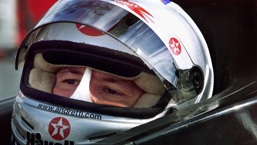 """FILE - In this Sept. 1, 2000, file photo, Newman/Hass Racing's Michael Andretti sits in his car prior to practice session at the Vancouver Indy. In the lead-up to the 100th running of the """"The Greatest Spectacle in Racing,"""" The Associated Press interviewed the 27 living race winners on topics ranging from the greatest driver to most memorable moment. Their answers to the best driver to never win the Indianapolis 500 gave Michael Andretti a distinction he'd rather go to anyone else.  (Kevin Frayer/The Canadian Press via AP, File)"""