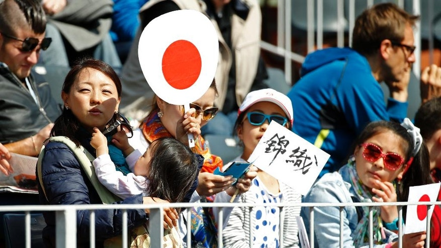 Spectators wait for the start of the second round match of the French Open tennis tournament between Japan's Kei Nishikori and Russia's Andrey Kuznetsov at the Roland Garros stadium in Paris, France, Wednesday, May 25, 2016. (AP Photo/Alastair Grant)