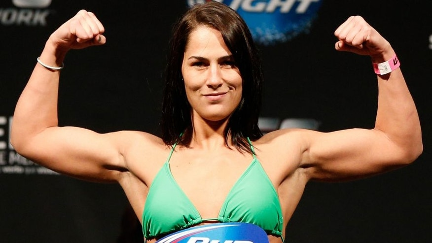 MEXICO CITY, MEXICO - NOVEMBER 14: Jessica Eye of the United States poses on the scale after weighing in during the UFC 180 weigh-in inside the Arena Ciudad de Mexcio on November 14, 2014 in Mexico City, Mexico. (Photo by Josh Hedges/Zuffa LLC/Zuffa LLC via Getty Images)