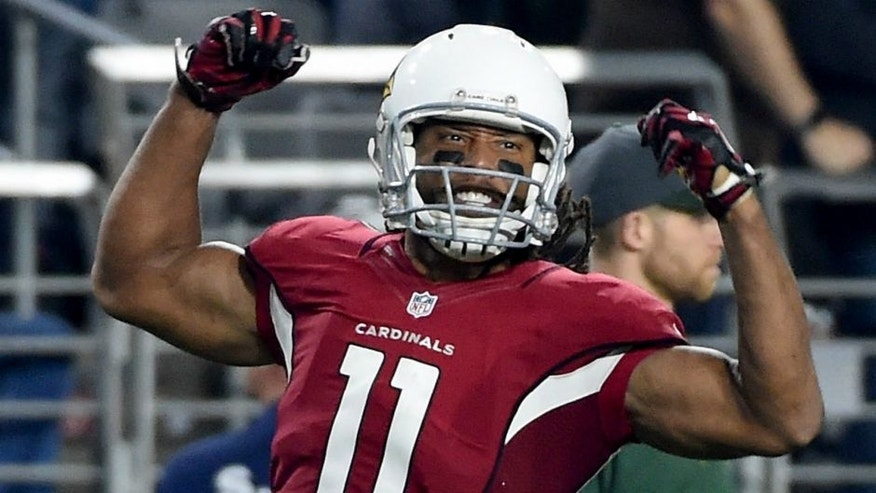 in the NFC Divisional Playoff Game at University of Phoenix Stadium on January 16, 2016 in Glendale, Arizona.,GLENDALE, AZ - JANUARY 16: Wide receiver Larry Fitzgerald #11 of the Arizona Cardinals reacts after making a catch during the third quarter of the NFC Divisional Playoff Game at University of Phoenix Stadium on January 16, 2016 in Glendale, Arizona. (Photo by Norm Hall/Getty Images)
