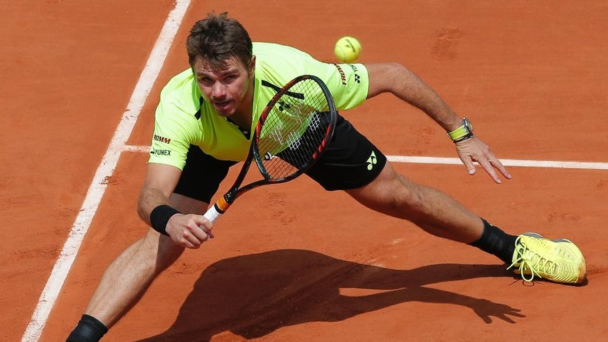 Switzerland's Stan Wawrinka returns the ball to Japan's Taro Daniel during their second round match of the French Open tennis tournament at the Roland Garros stadium, Wednesday, May 25, 2016 in Paris.  (AP Photo/Christophe Ena)