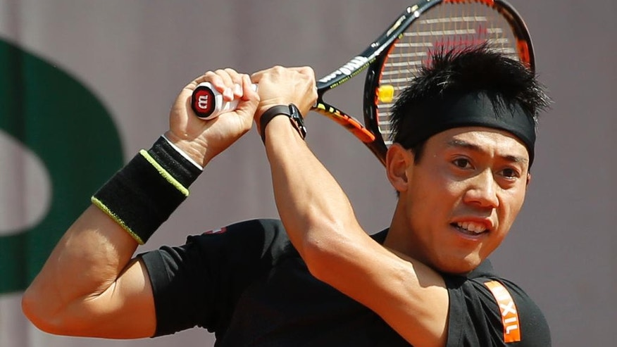 Japan's Kei Nishikori returns in his second round match of the French Open tennis tournament against Russia's Andrey Kuznetsov at the Roland Garros stadium in Paris, France, Wednesday, May 25, 2016. (AP Photo/Alastair Grant)