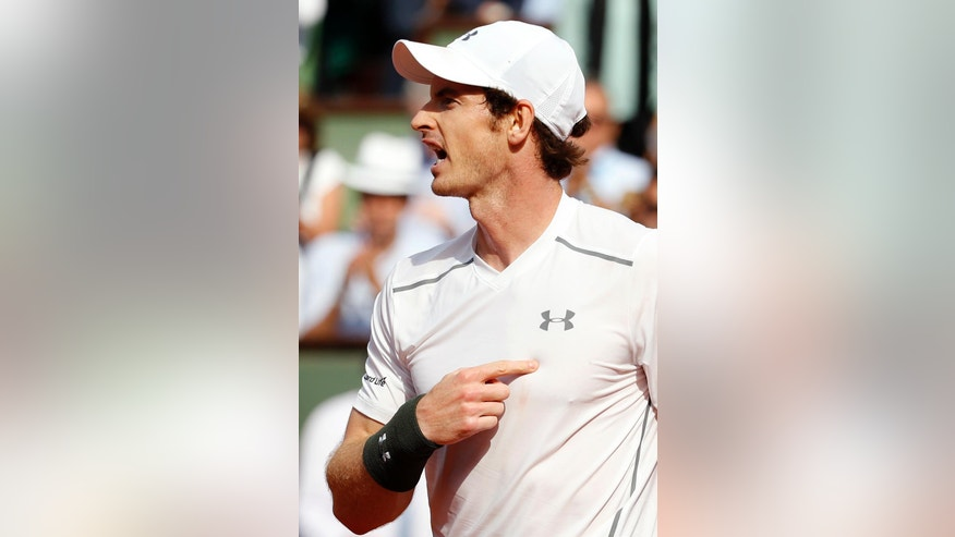 Britain's Andy Murray gestures after winning his second round match of the French Open tennis tournament against France's Mathias Bourgue at the Roland Garros stadium in Paris, France, Wednesday, May 25, 2016. (AP Photo/Alastair Grant)